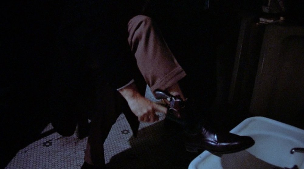 gene-hackman-in-the-french-connection-adjusts-his-ankle-holster.jpg